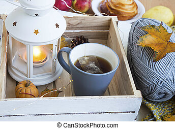 Cosy autumn with tea cup, lantern and knitting wool - Cosy...