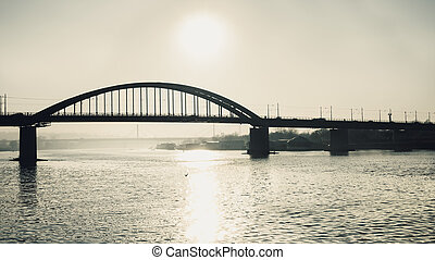 Sun above the bridge - Sun reflection in the river with...