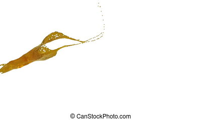 yellow color splash in slow motion. syrup - close-up view of...
