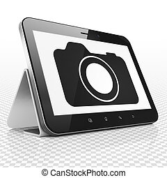 Travel concept: Tablet Computer with Photo Camera on display...