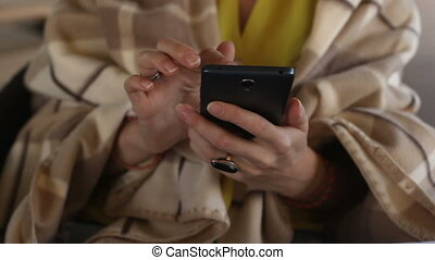 Woman using smartphone - Woman in yellow blouse with brown...