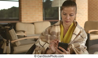 Woman using smartphone - Beautiful young woman in yellow...