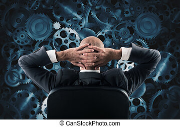Analyze a system - Businessman sitting in a chair watching...