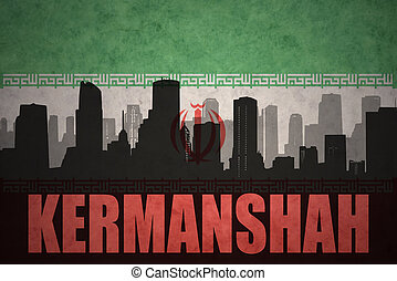 abstract silhouette of the city with text Kermanshah at the vintage iranian flag background