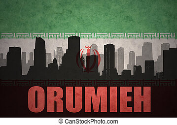 abstract silhouette of the city with text Orumieh at the vintage iranian flag background