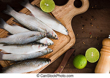 mullet - Seafood fresh mullet fish with lime and spice on a...