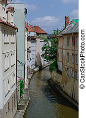 view from the Charles Bridge on the narrow Certovka Canal in Prague. Czech Republic