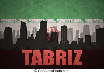 abstract silhouette of the city with text Tabriz at the vintage iranian flag background