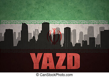 abstract silhouette of the city with text Yazd at the vintage iranian flag background