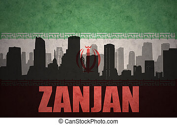 abstract silhouette of the city with text Zanjan at the vintage iranian flag background