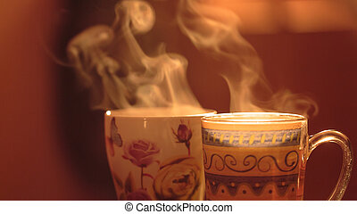 Steam from the mugs. Hot invigorating drink in a cup on a...