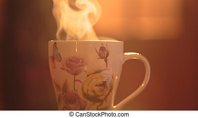 Steam from the mug. Hot invigorating drink in a cup on a...