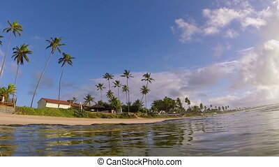 Tropical beach coast. Underwater view from sea