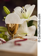 Symbol christianity religion a golden chalice with grapes...
