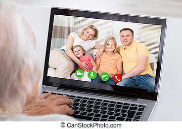 Grandmother Video Conferencing On Laptop - Close-up Of...