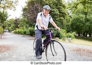 Senior Man Riding Bicycle