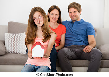 Girl Holding Small House Model