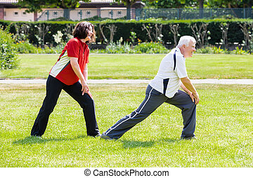 Couple Doing Work Out In Park