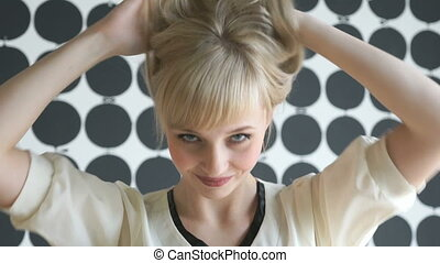 Attractive blonde model girl at the beauty salon