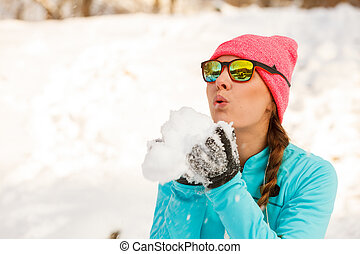 Girl having fun with snow. Winter park relax entertaiment...