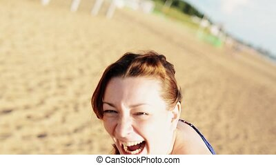 Happy young girl on beach with flower smile in camera. Sunny. Carefree. Dance