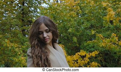 Beautiful girl is sad, in a park. - Beautiful girl is sad,...