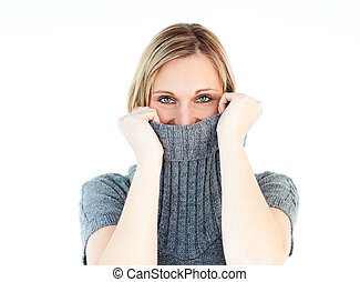 Cute young woman wearing a polo-neck sweater against white...