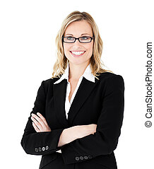 Self-assured businesswoman with folded arms against white...