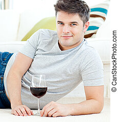 charming man lying with wine - charming man lying on the...