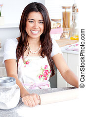 Bright asian woman baking in the kitchen