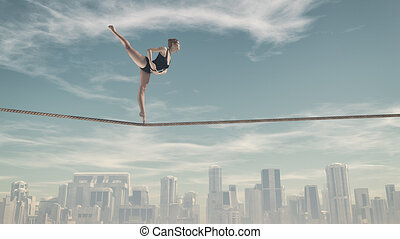 Woman sitting on a rope - Athletic woman training on a rope...