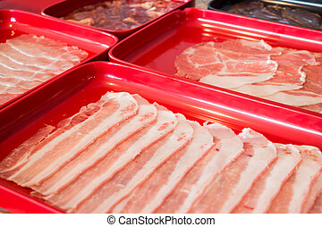 Raw sliced pork preparing for homemade sukiyaki, stock photo
