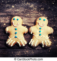 Christmas homemade gingerbread man cookie on wooden table...