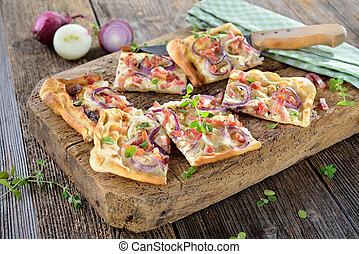 Traditional Alsatian tarte flambee - Hot baked tarte flambee...