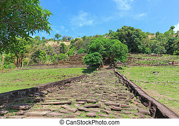 Stoney walkway and staircase leading to upper level of rained Vat Phou (Wat Phu) in Laos