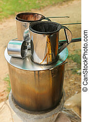 Pot of hot water boiler on wood fueled stove with coffee...