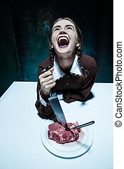 Bloody Halloween theme: crazy girl with a knife, fork and...