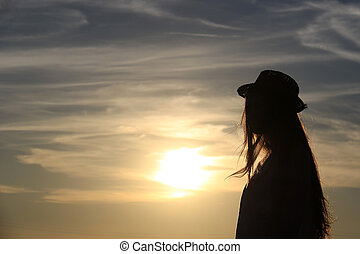 Girl Silhouette - A girl's silhouette against the sun with...
