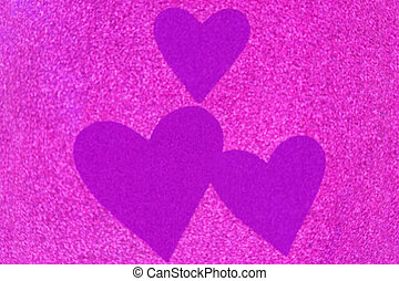Glittery texture of glitter in magenta with blurred purple...