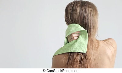 Women wipes her hair