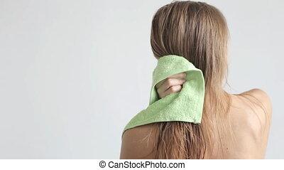 Women wipes her hair