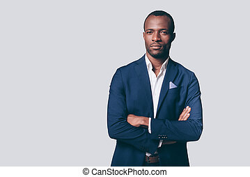 Portrait of confidence. Handsome young African man in smart...