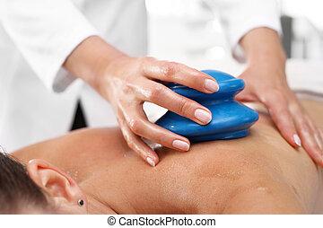 Chinese bubble. Back massage - Masseur massaging her back...