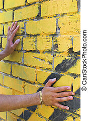 Man\'s hands on the wall