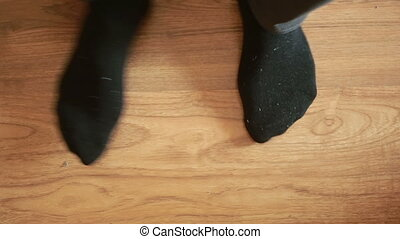 Man putting socks. man removes socks. close-up - man removes...