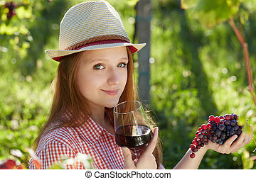 Happy Attractive Woman Enjoying a Glass of Wine at the...