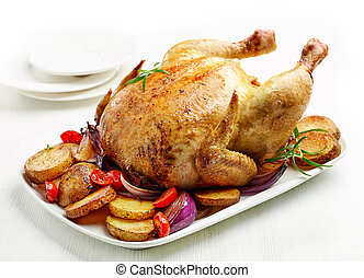 whole roasted chicken on white plate