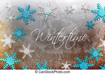 Wintertime - Snow crystals of different colors on an icy...