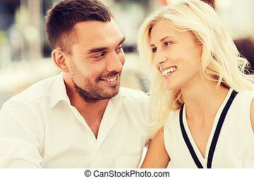 smiling happy couple outdoors - love, date, affection,...