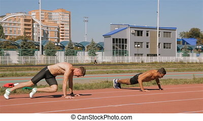 Two athlets prepare for training - Two caucasian male...